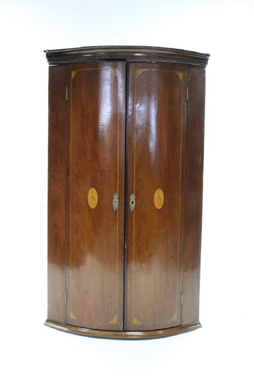 c19th inlaid mahogany barrel fronted two door corner cupboard