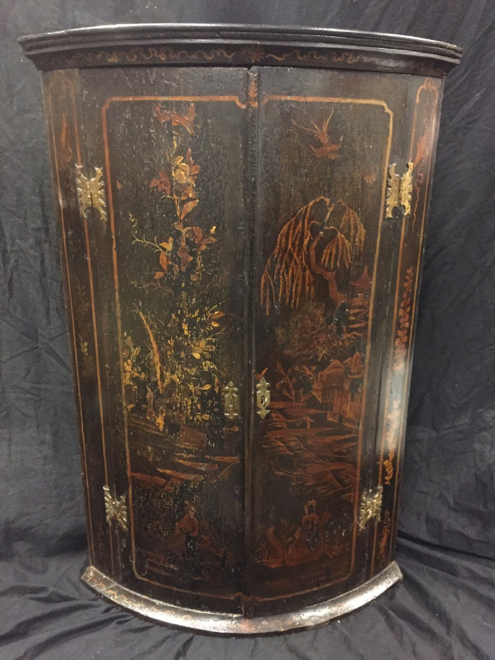c18th bow fronted lacquered chinoiserie corner cupboard