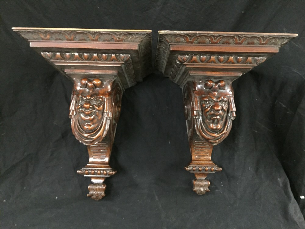 c19th pair of walnut wall brackets