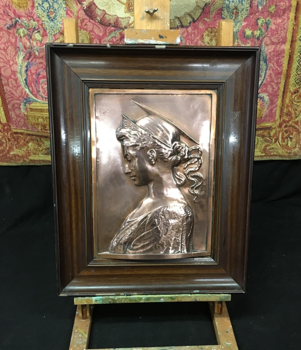 c19th copper embossed plaque in a painted wooden frame in the pre raphaelite taste