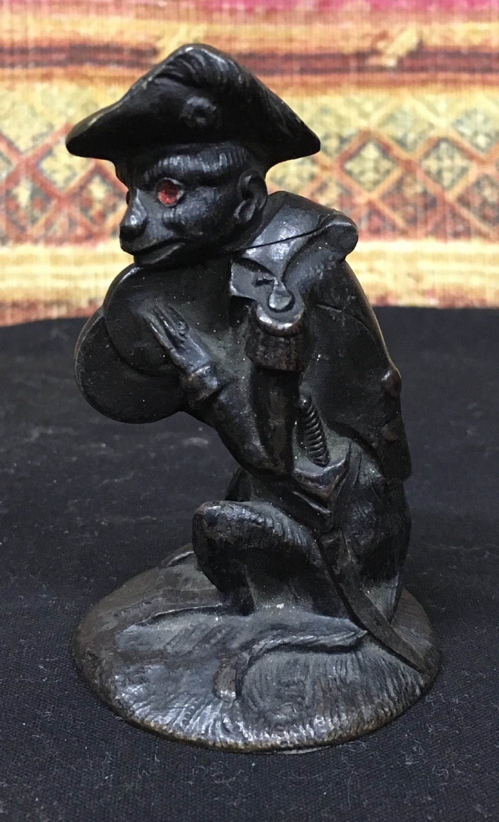 bronze vesta depicting a monkey in uniform
