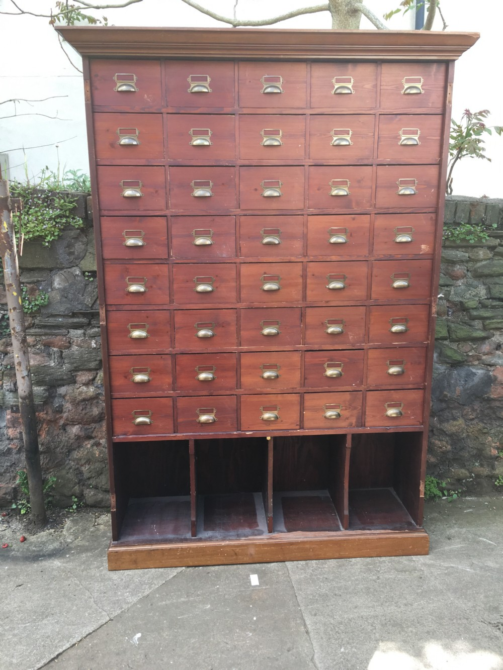 a large c19th bank of 40 pine drawers