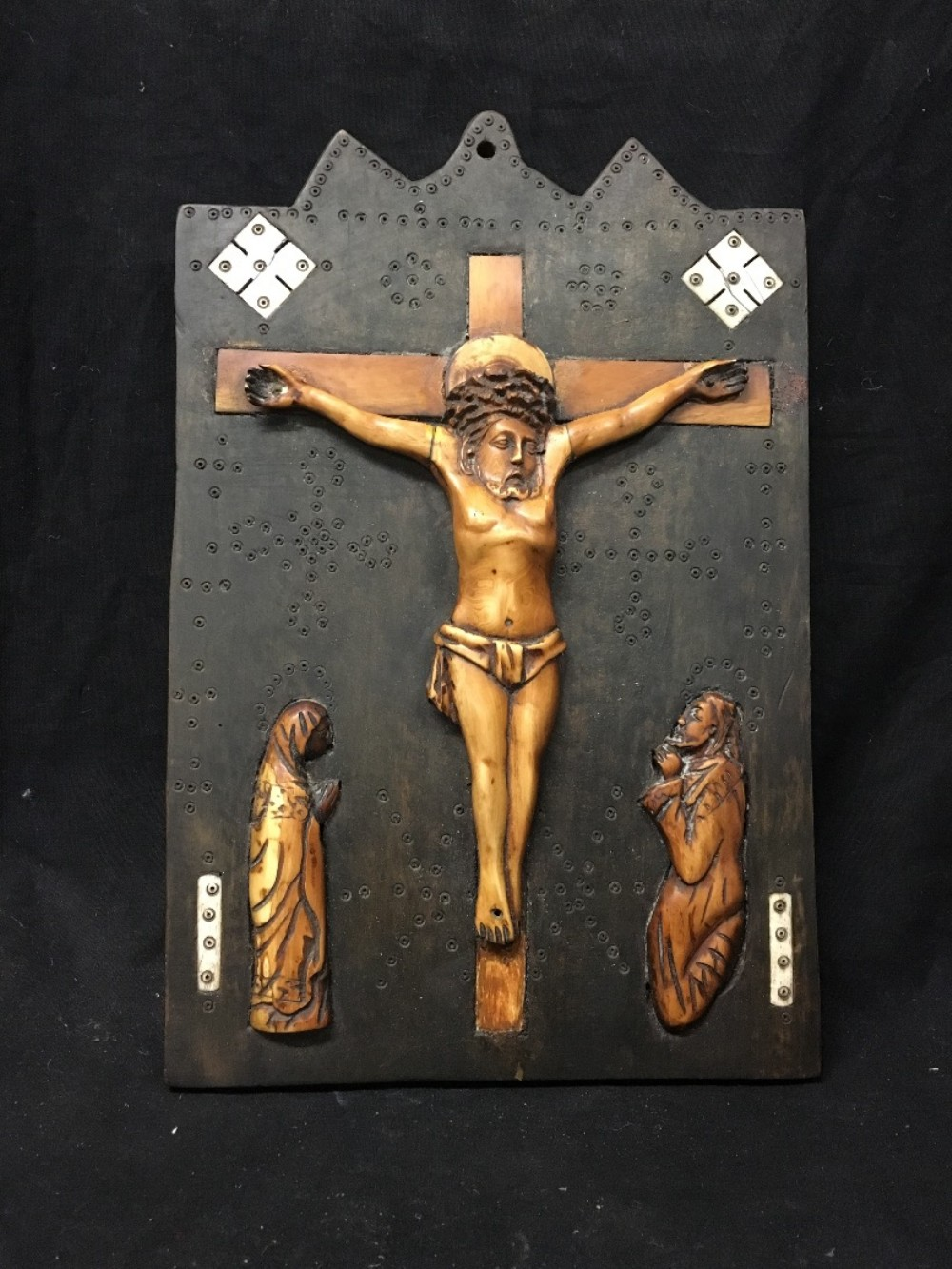 c18th bone crucifix on wooden back