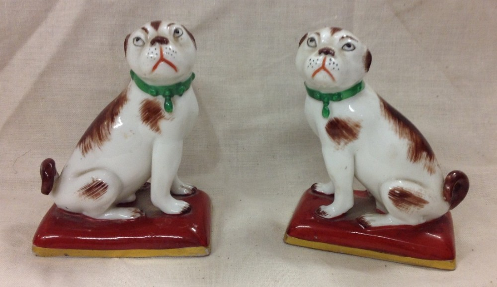 c19th pair of miniature seated dogs on cushions
