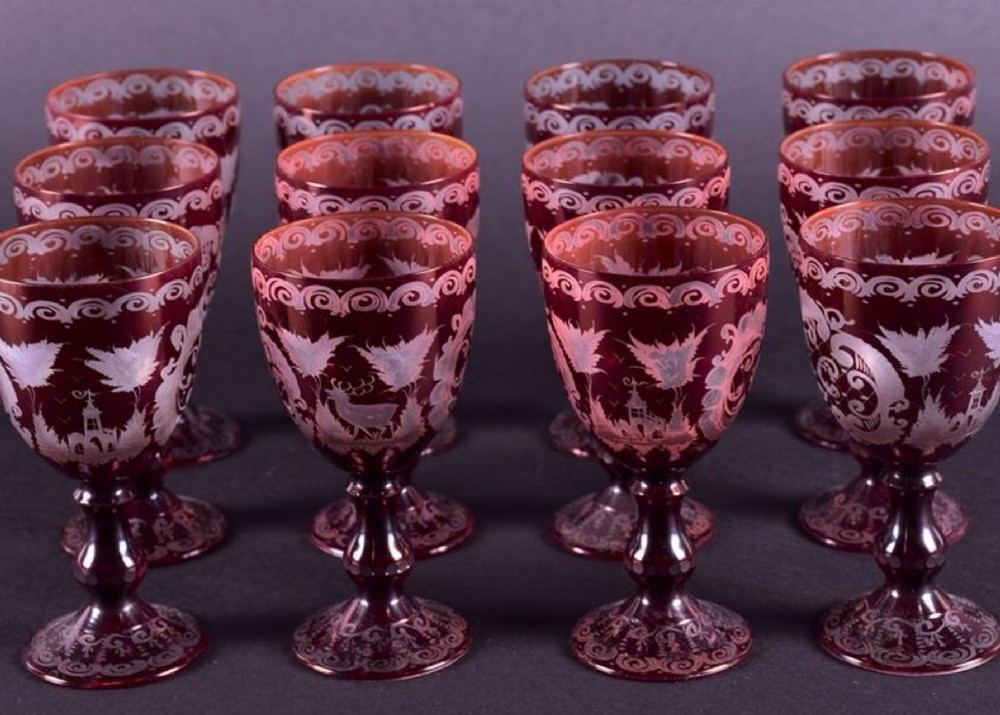 set of twelve etched ruby red wine glasses in the bohemian style