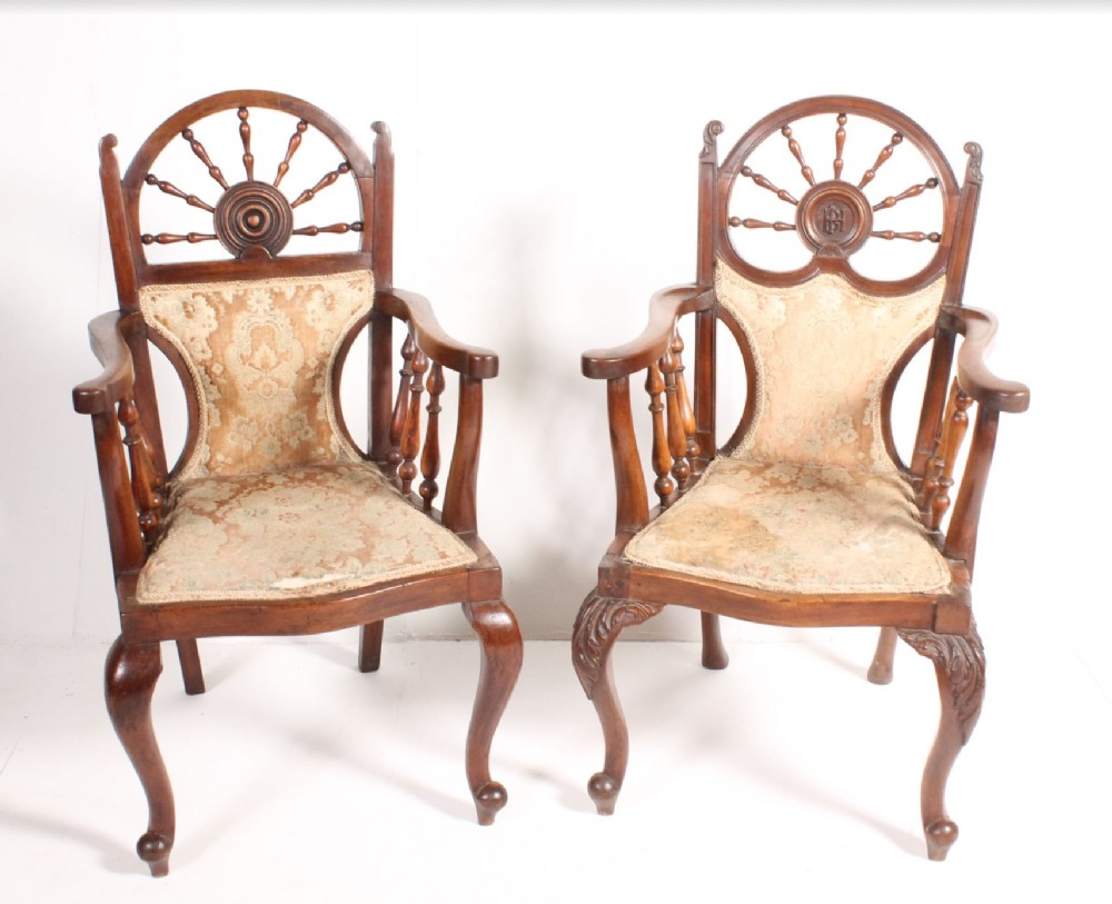two armchairs with nautical themed backs