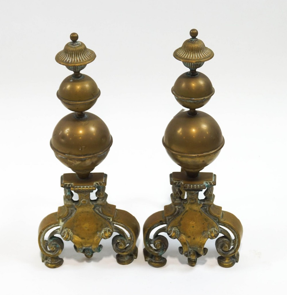a large pair of brass andirons