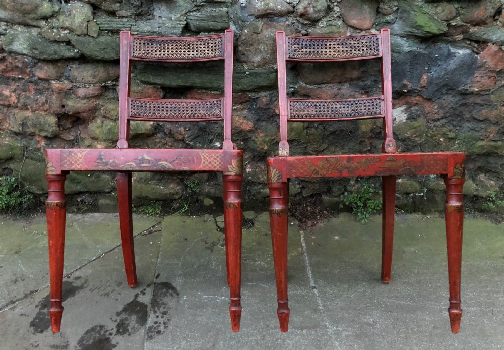 a good pair of chinoiserie decorated red lacquered chairs