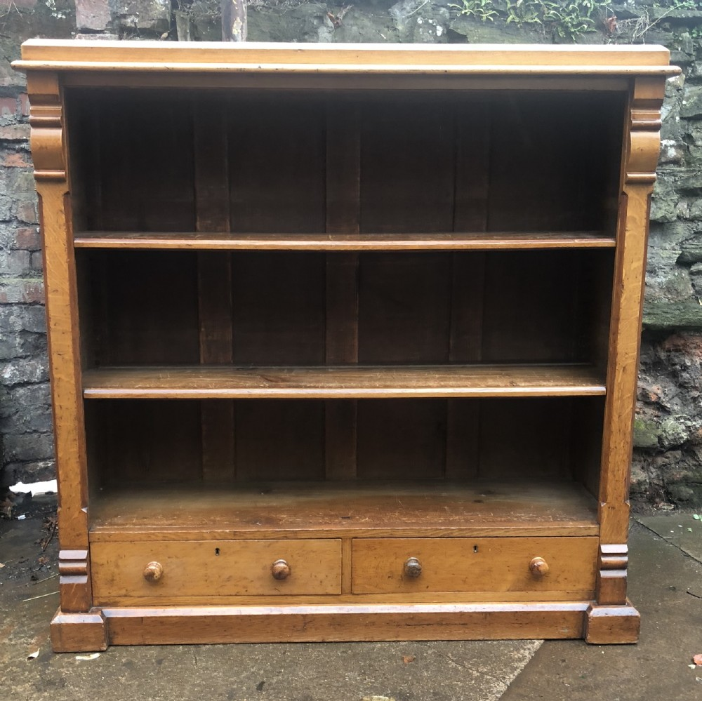 c19th golden oak floor standing bookcase with two drawers