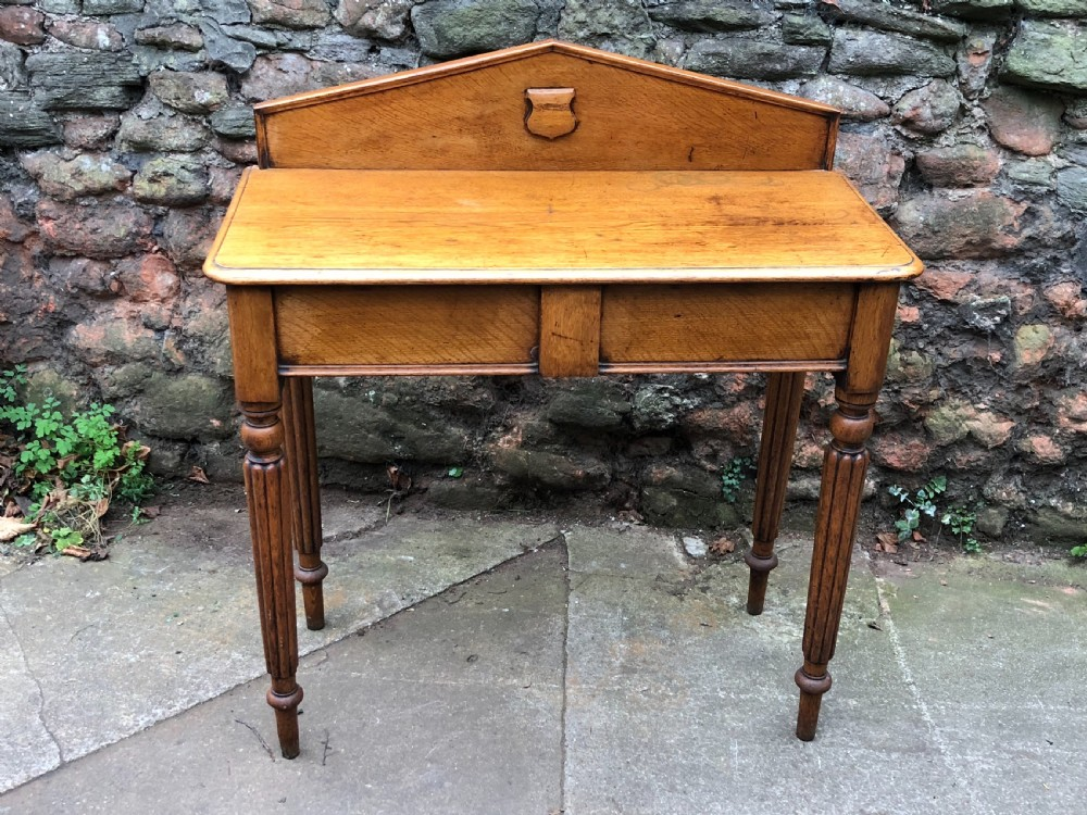 c19th golden oak hall table of small proportions on fluted legs