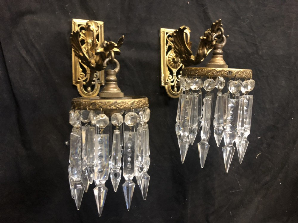 edwardian pair of wall lights shaped as griffins with cut glass lustre drops