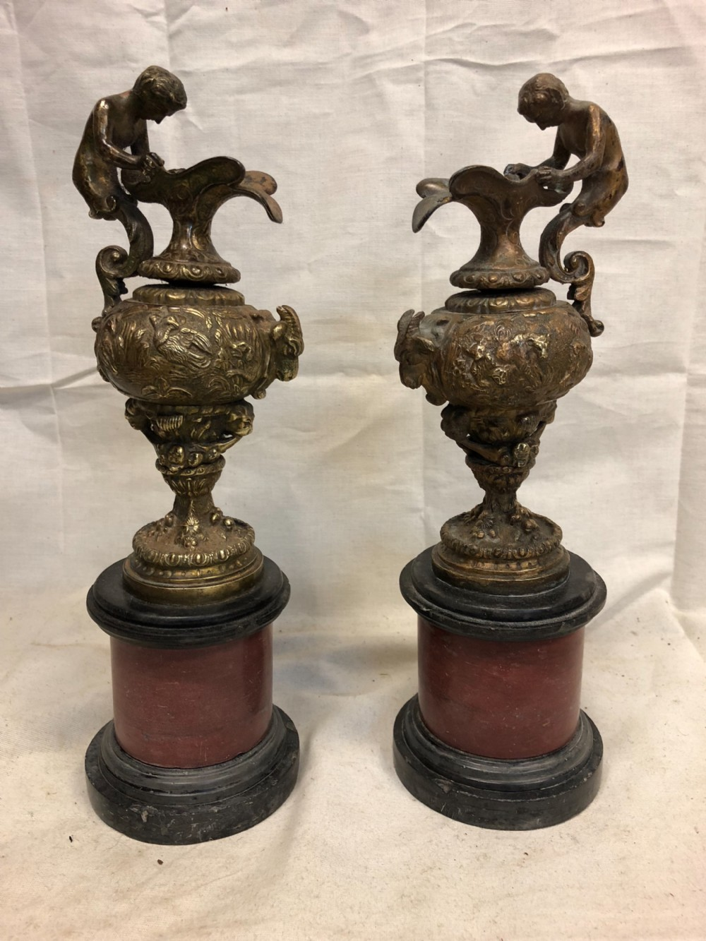 pair of classical gilt bronze urns on marble bases
