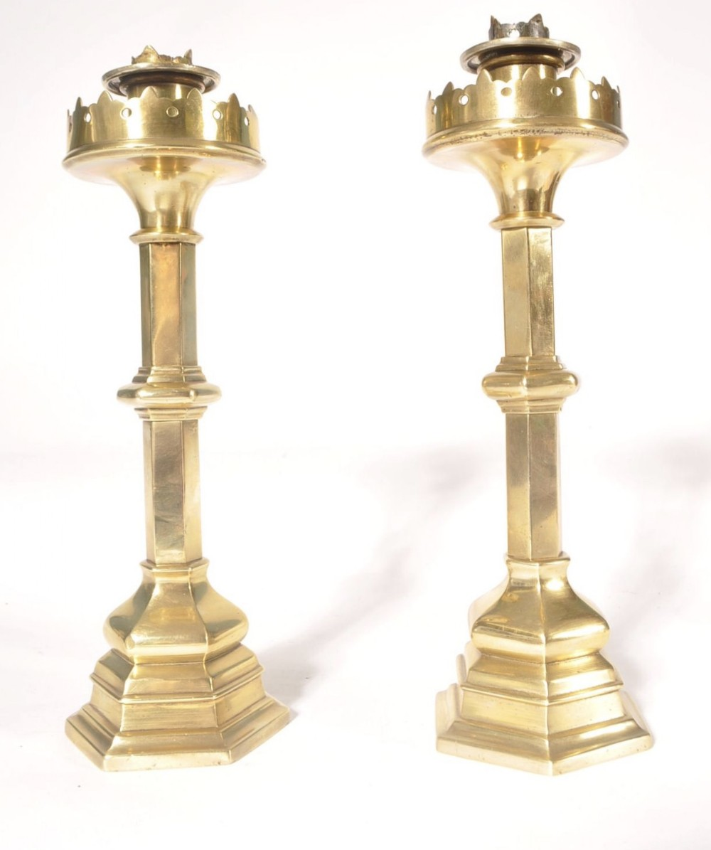 pair of heavy brass gothic candlesticks