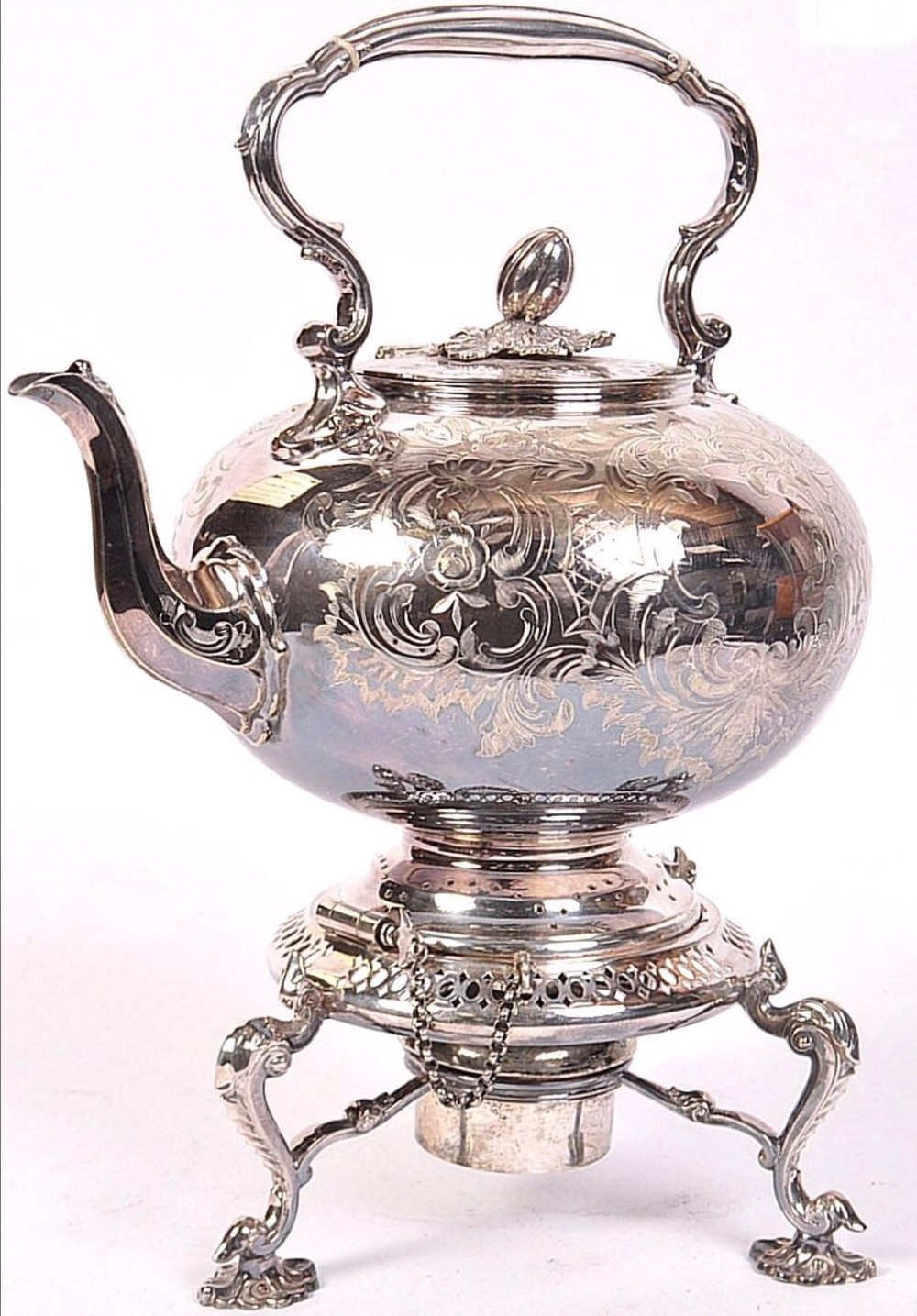 a large silver plated kettle on stand