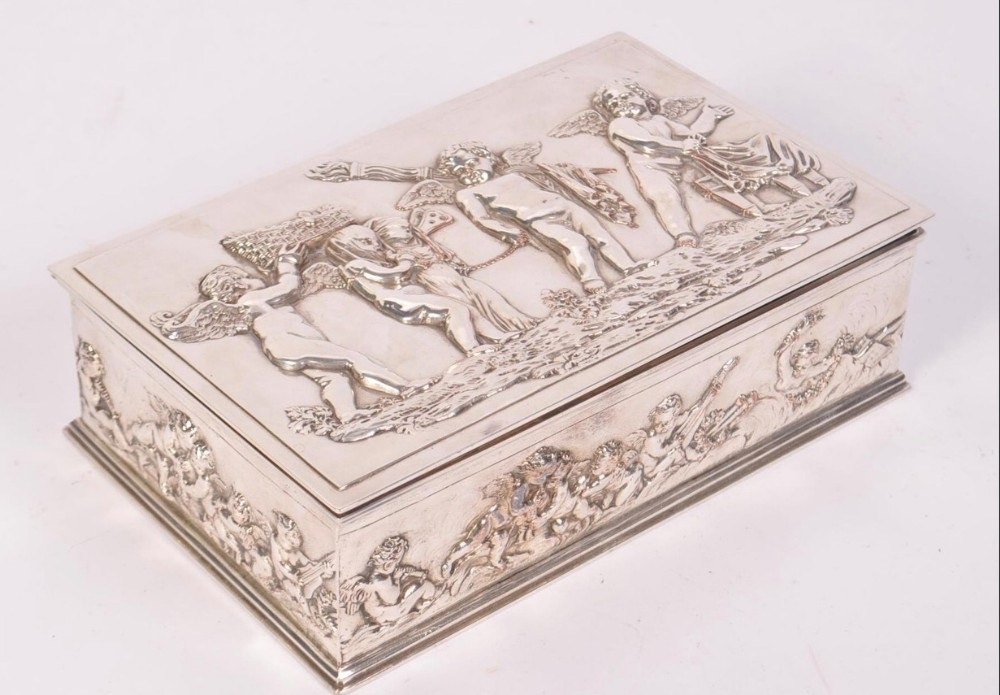 a silver plated box with cavorting cherubs