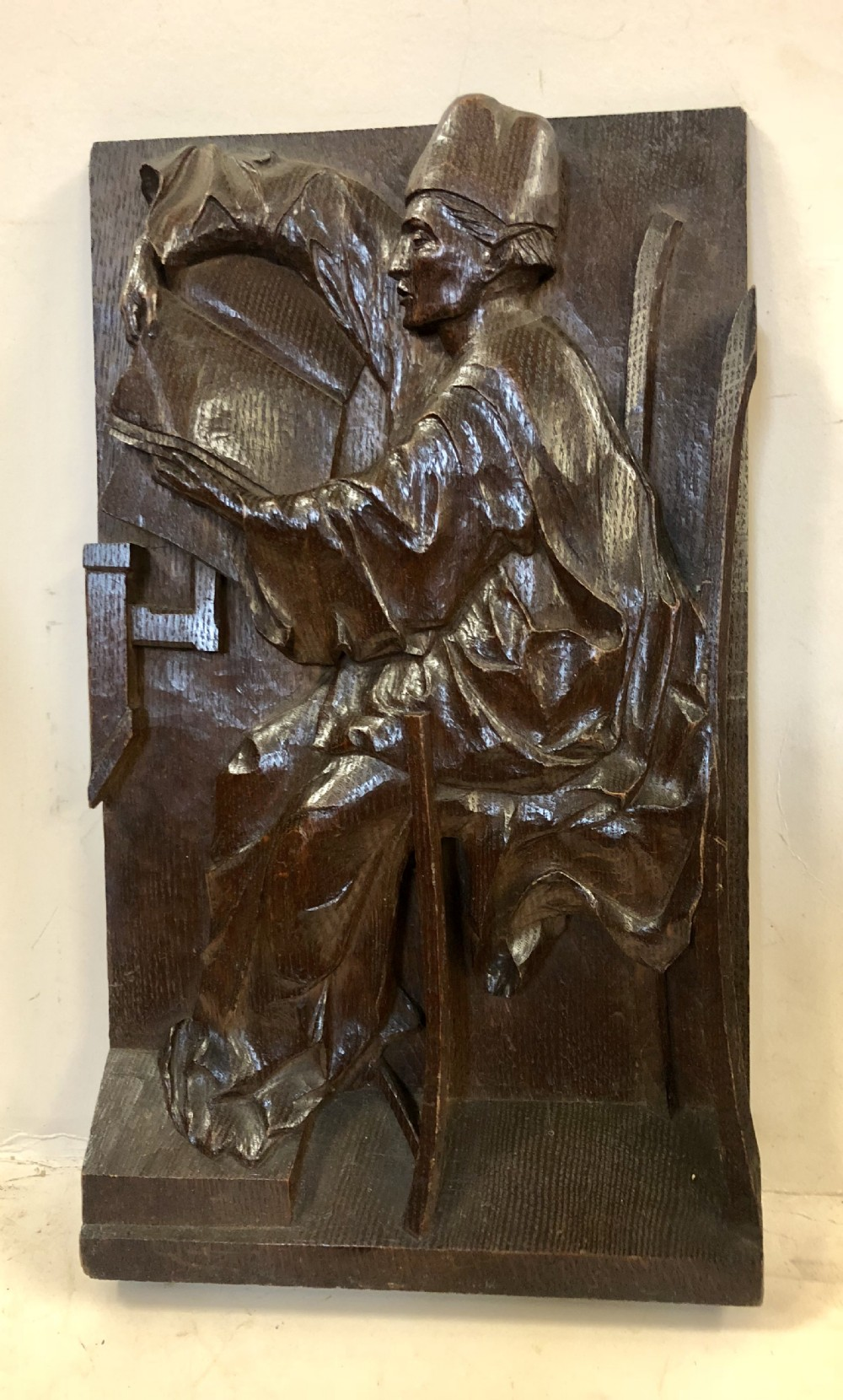 c18th relief carving in oak of a scholar