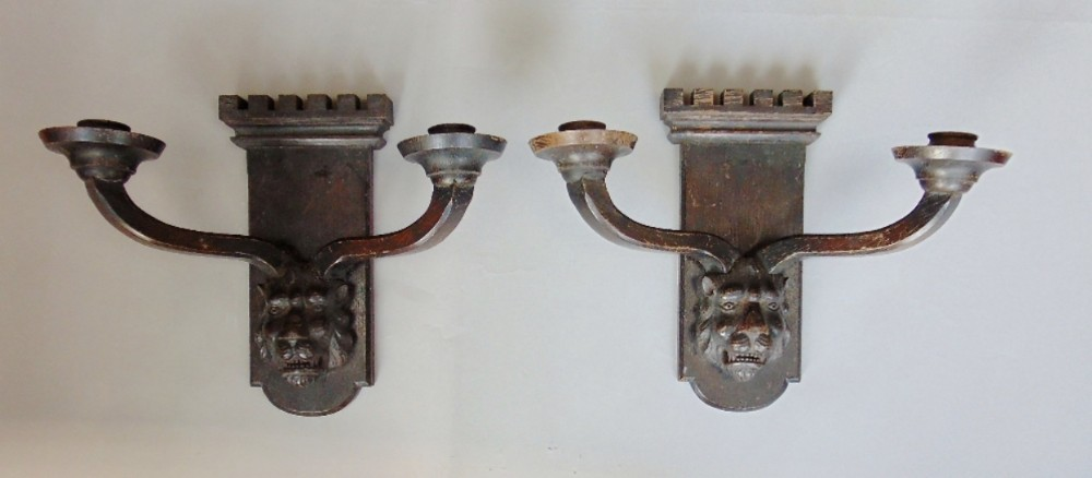 pair of carved wooden wall lights