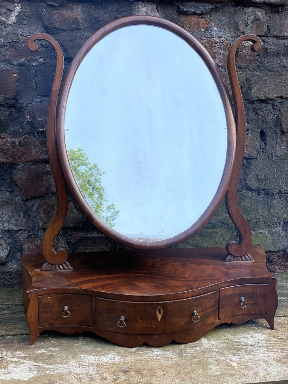 early c19th serpentine fronted toilet mirror with oval mirror