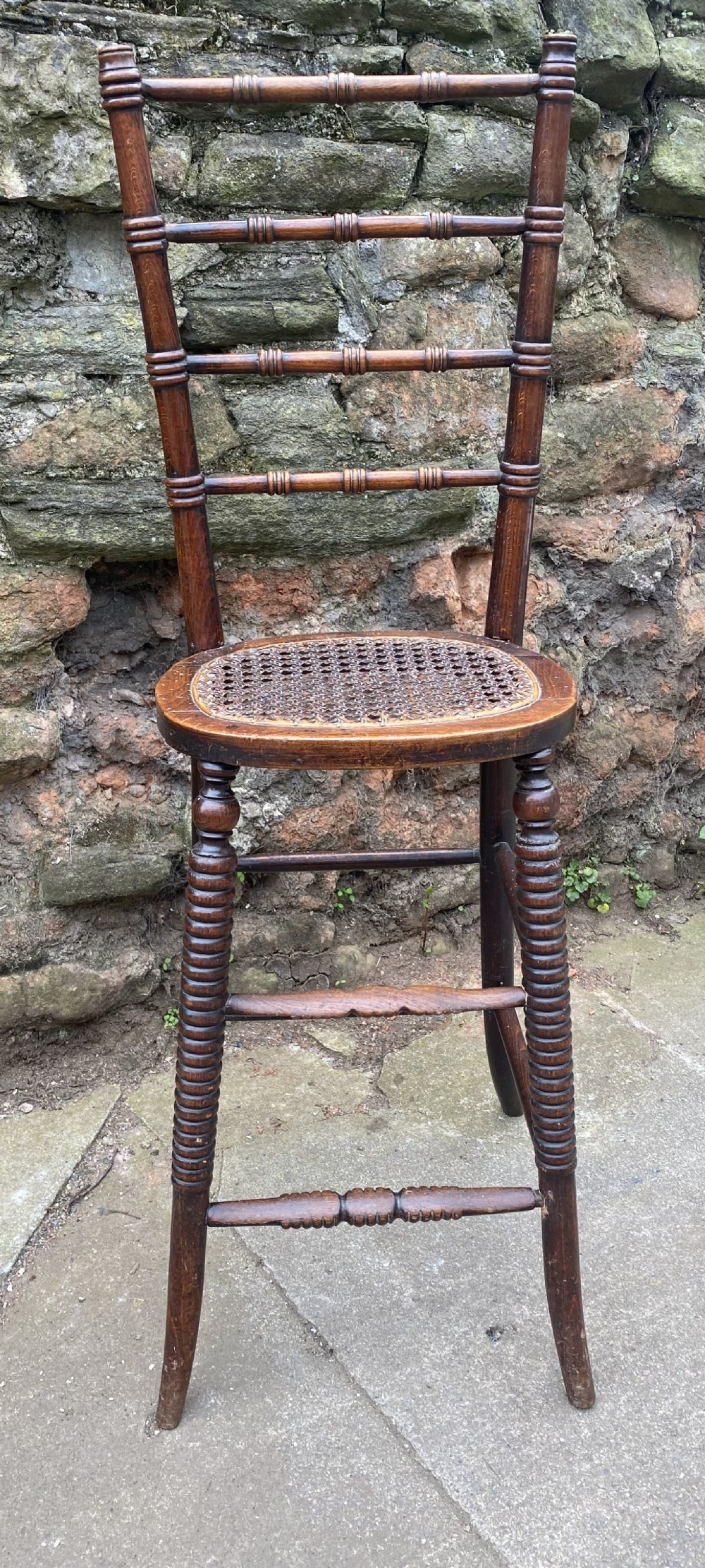 correctional deportment chair regency in stained beech with caned seat